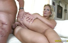Enticing blond Kristy Kelly swallows a giant cock like a pro