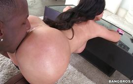 Mouthwatering dark-haired Nikki Benz with massive tits pulls her thong aside to take a large cock